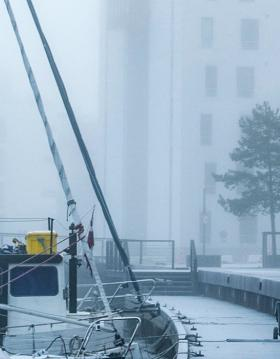 Snow and fog on the harbour in Odense